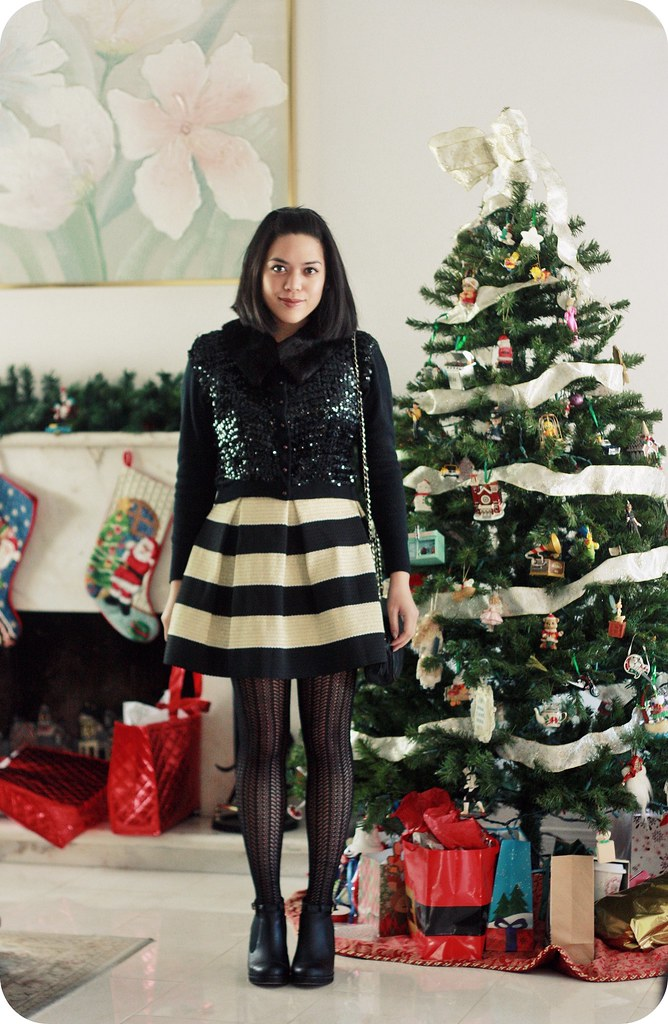 Sweets & Hearts holiday fashion and style: outfit featuring thrifted vintage mink fur collar sequin cardigan, black and gold striped skirt, Betsey johnson tights, ankle boots