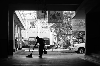 Imageof Saints Michael and the Archangels Parish. school white black college silhouette contrast campus beda san floor ground cleaning manila inside sweep employee sweeping personel mendiola