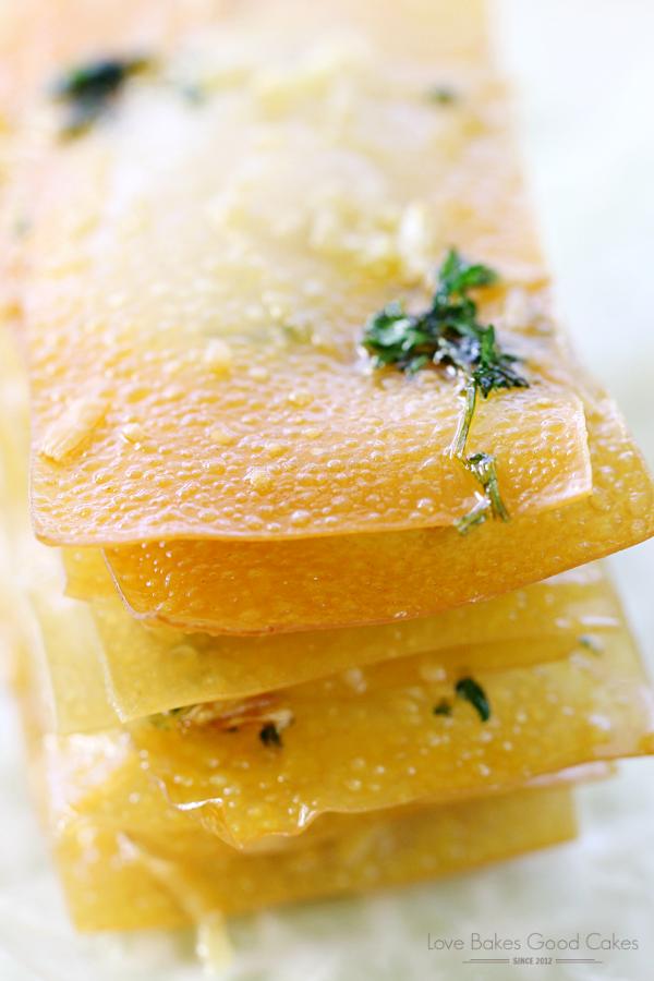Garlic Parmesan Wonton Crisps close up on a plate.
