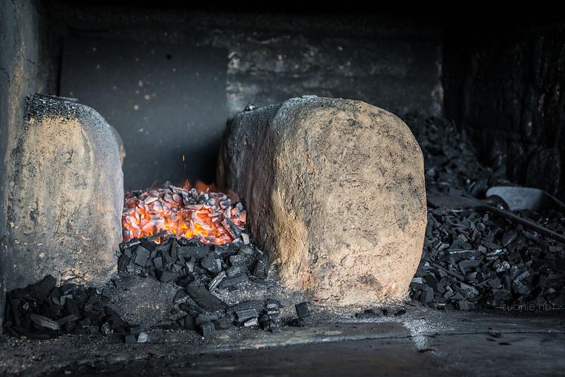 Blacksmith Sri Gading - coal in the forge