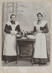 Portrait of two women and their cooking utensils
