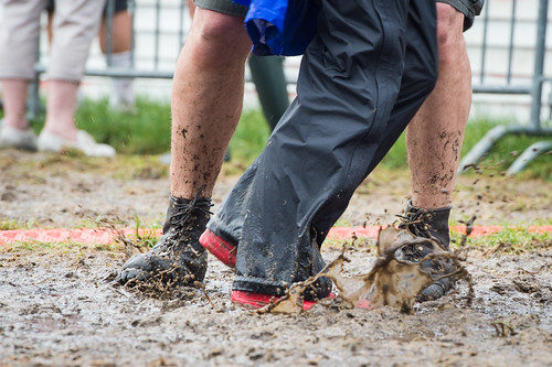 Dancing in the mud at Jazz Fest 2016 Day 4.  Photo by Kate Gegenheimer