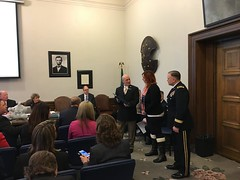 Rep. Brad Klippert presenting Alex McClintock, wife of fallen National Guard Sgt. Matthew McClintock, with a resolution in caucus