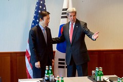 U.S. Secretary of State John Kerry helps Republic of Korea Foreign Minister Yun Byung-Se to his seat on February 12, 2016, at The Charles Hotel in Munich, Germany, before a bilateral meeting on the margins of the Munich Security Council. [State Department photo/ Pubic Domain]