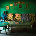 Old woman inside her house decorated with old pictures of her relatives, Omo valley, Jinka, Ethiopia by Eric Lafforgue