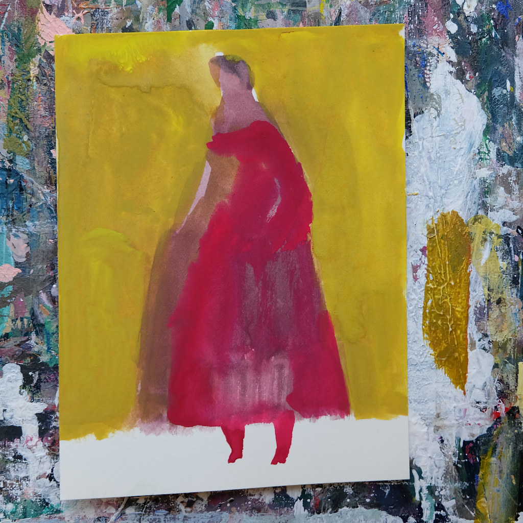 figure with yellow