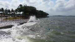 Waves at high tide splashing on the boardwalk