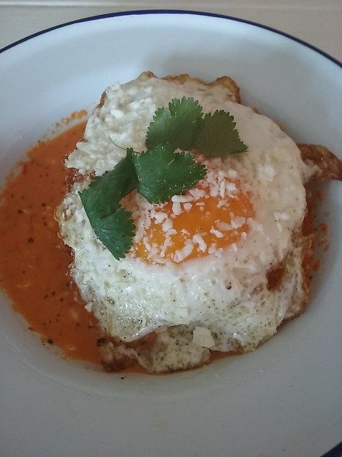Crispy hash brown chilaquiles with sunny-side up egg, cotija and salsa macho