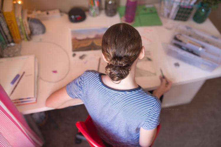 girl working on homework 01-750
