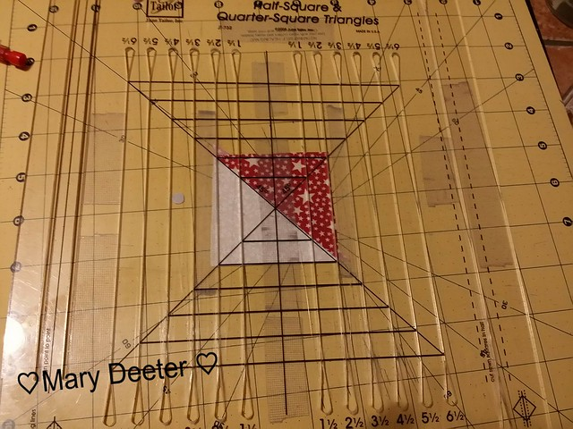 Trimming using the June Tailor Perfect half square triangles ruler