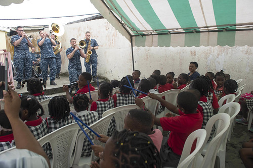 "Thu, 04/14/2016 - 08:56 - 160414-N-WV703-335 LIBREVILLE, Gabon - (April 14, 2016) Members of the U.S. Naval Forces Europe Band, ""Topside"", perform for students at the Abraham Lincoln Leaders School as part of Africa Partnership Station (APS) in Libreville, Gabon April 14, 2016. APS, an international collaborative capacity- building program, is being conducted in conjunction with a scheduled deployment by the Military Sealift Command expeditionary fast transport vessel USNS Spearhead (T-EPF 1). (U.S. Navy photo by Mass Communication Specialist 3rd Class Amy M. Ressler)"
