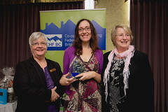 CHF Canada presents Tidal Flats Co-op with an award for 30 years of CHF Canada membership.