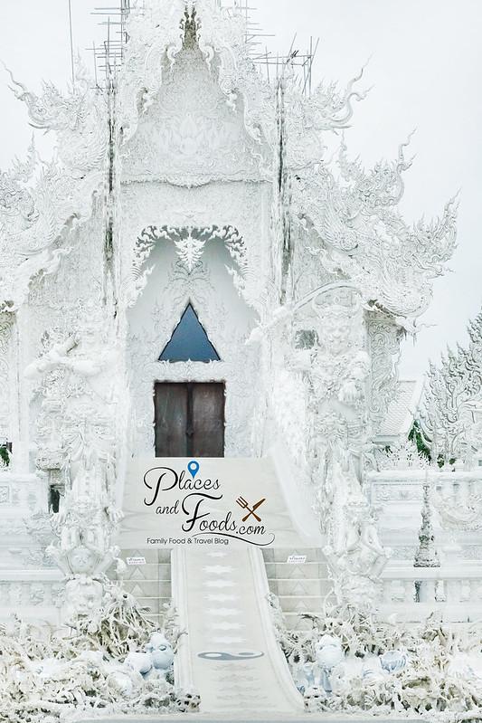 chiang rai white temple mid vertical tight shot