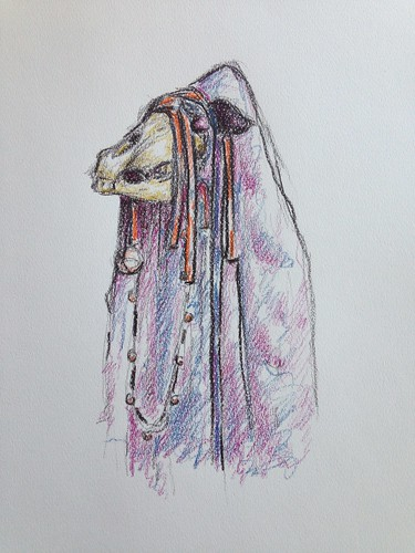 Mari Lwyd, a Welsh Christmas folk custom, involving song or poetry, alcohol and a decorated horse skull on a stick.