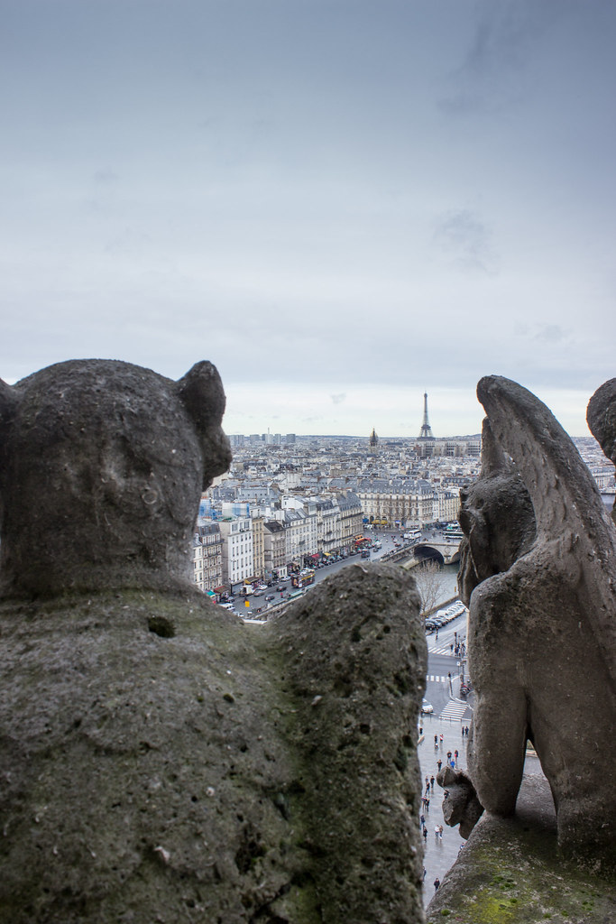 Gargoyles of Notre Dame looking out at the Eiffel Tower