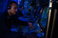 In this file photo, Operations Specialist 2nd Class Alejandro Valdez identifies contacts within USS John C. Stennis' (CVN 74) combat direction center. (U.S. Navy/MC3 Kenneth Rodriguez Santiago)