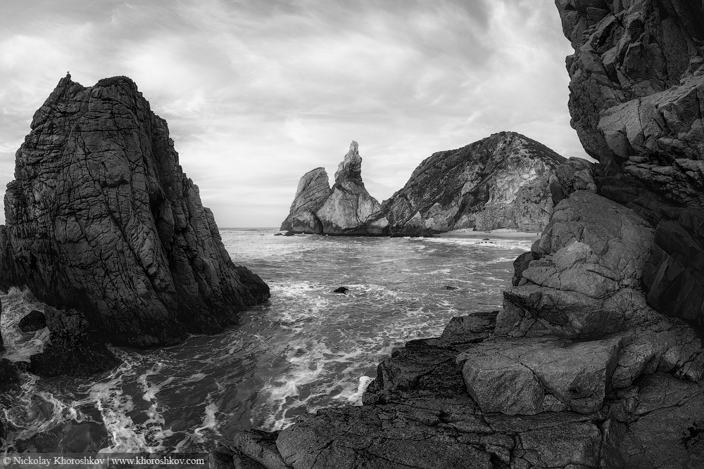 Black and white photo of rocky coastline of Atlantic ocean