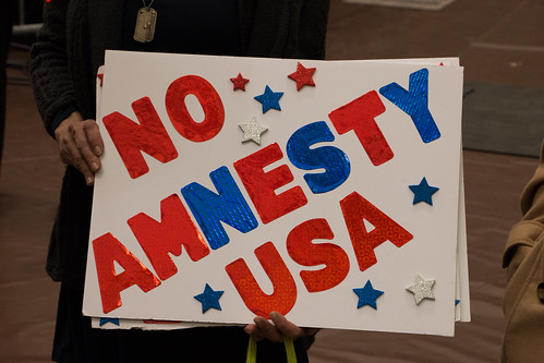 Siron holds up another of the six different signs she made for the Donald Trump rally in Radford University's Dedmond Center on Feb. 29, 2016. Photo by Scott Beaubien.