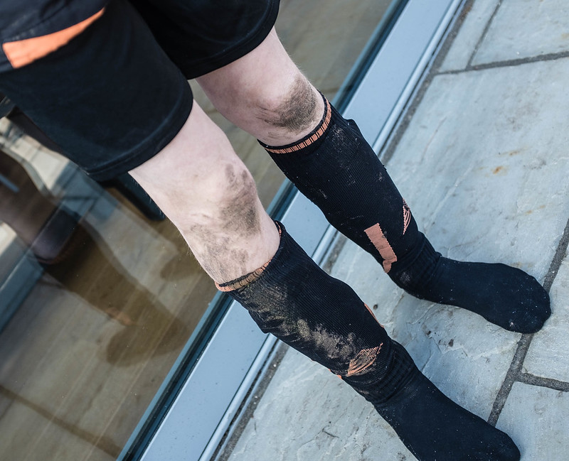 The muddy knees of a league winner