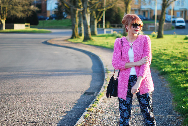 Spring style: Fluffy pink cardigan, paisley joggers, up do, cat eye sunglasses, evil eye brooch