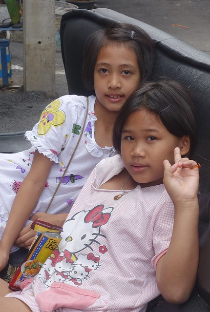 girls on a sofa in the middle of the street