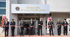 U.S. and Republic of Korea officials cut the ribbon during a ceremony marking the opening of CNFK's new headquarters building. (U.S. Navy/MC3 Jermaine M. Ralliford)