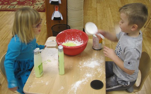 mixing up the cornstarch and hair conditioner play dough