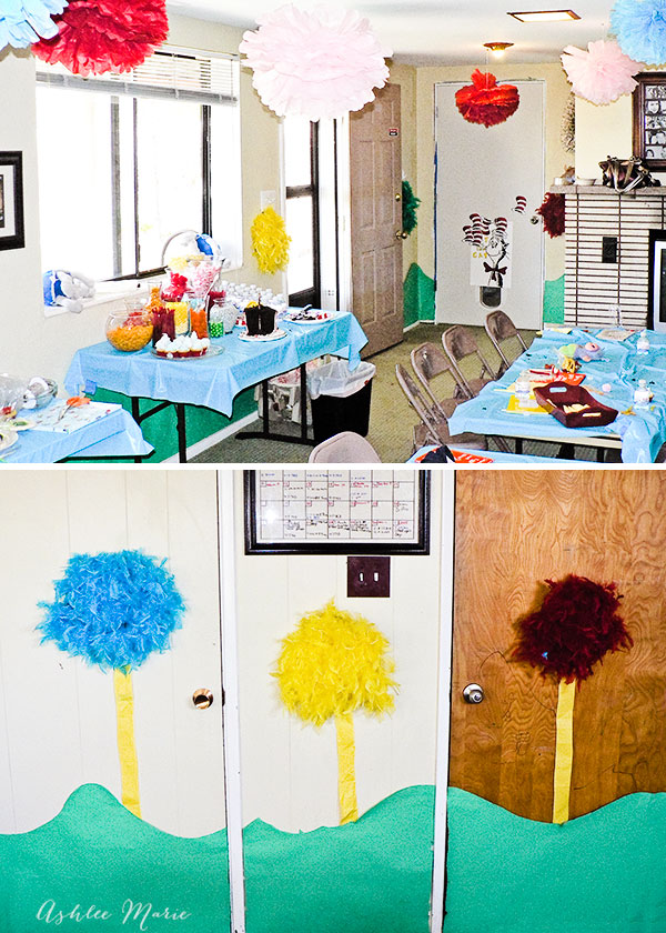 a sweet dr seuss birthday party, the decor includes homemade truffula trees, tissue pom pom's, lots of candy, games and party favors