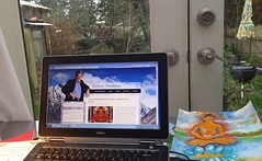 """Watching Dr. Bob Thurman's podcast """"We Can Make Miraculous Change - A Special Losar"""", laptop, solarium looking into the winter Garden for Bodhisattvas, Seattle, Washington, USA"""