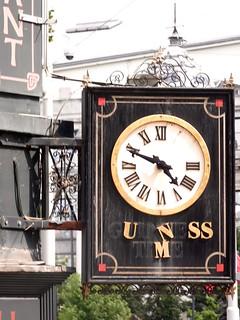 Old Guinness Clock Sign of Celtic Ireland Pub in Antwerp Belgium