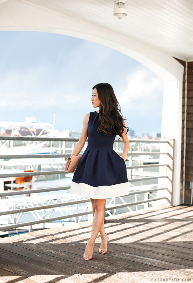 spring wedding guest outfit navy flare dress