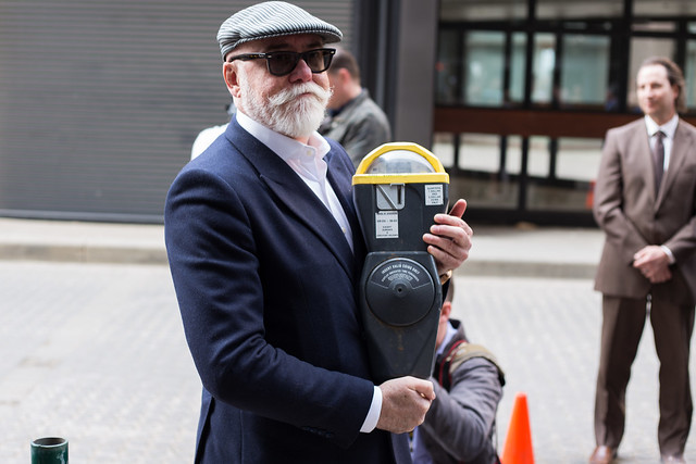Councillor Scott McKeen with the last parking meter