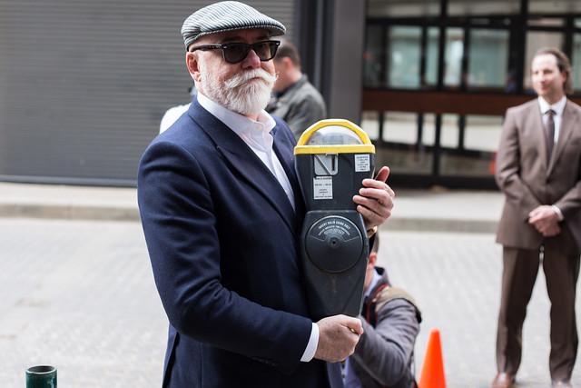 Councillor Scott McKeen with the last parking meter