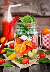 Fresh healthy vegetable salad in glass jar