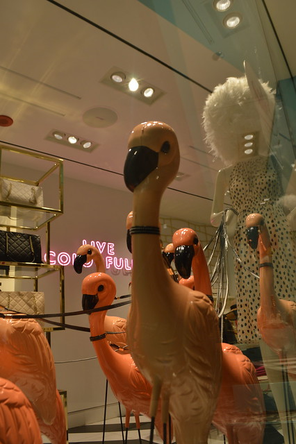 Pink Flamingos window display at retail store on The Magnificent Mile in Chicago, Illinois, USA