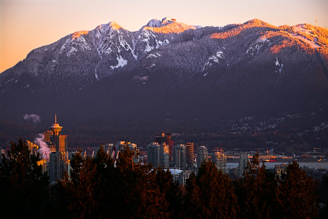 Vancouver Downtown Skyline with Snow Capped Mountains at Sunrise