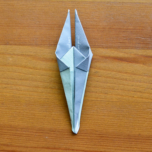 Step 12. Fold wings in and upward, fold remaining corners to center line (on both sides)