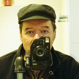 reflected self-portrait with Canon Zoom XL camera and peaked cap