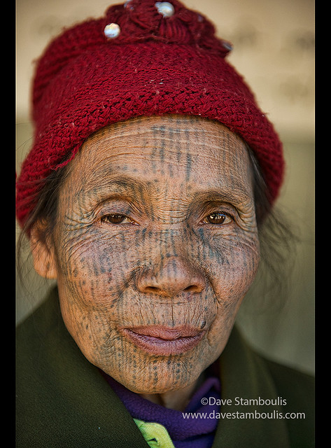 A Yindu Chin woman with face tattoos in Kanpetlet, Myanmar