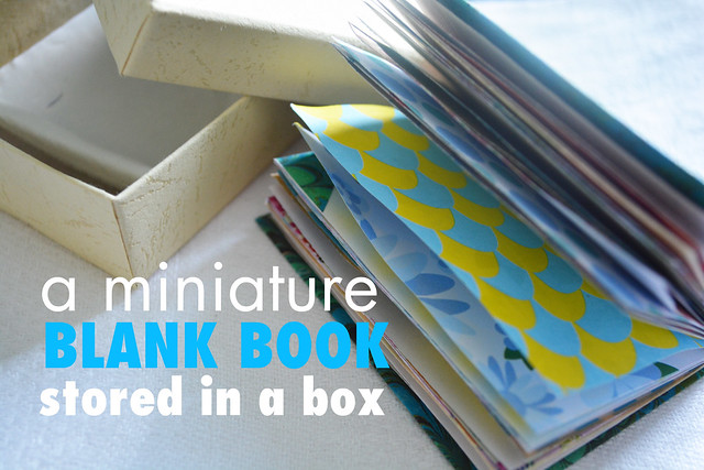 A miniature blank book in a tiny box