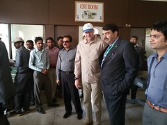 Brig. Ali Raja explaining the working to Mr. Carsten and Wajid Junejo at Technical Training Center