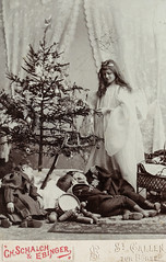 Cabinet card of an angel visiting children on Christmas