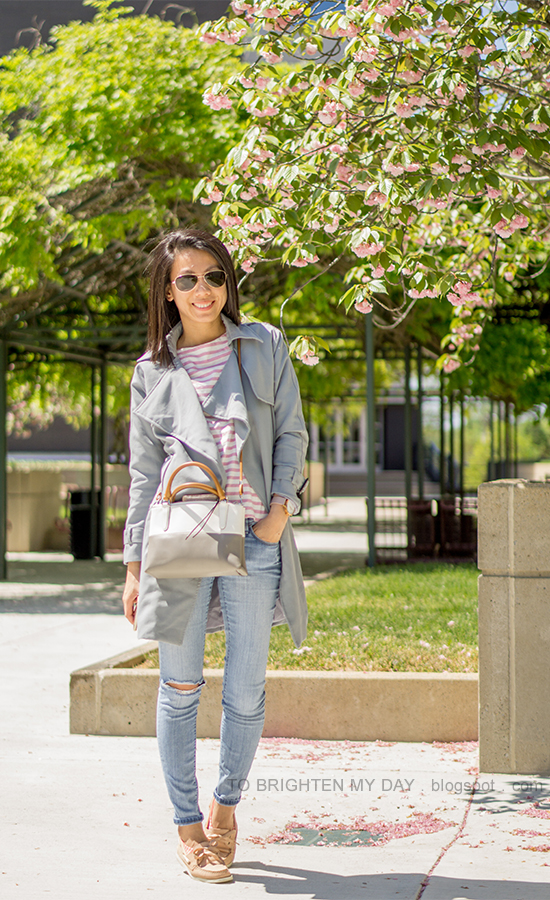 blue gray drape trench coat, striped top, light wash distressed jeans, colorblocked crossbody bag, pink boat shoes