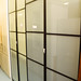 Tall two door frosted glass storage unit