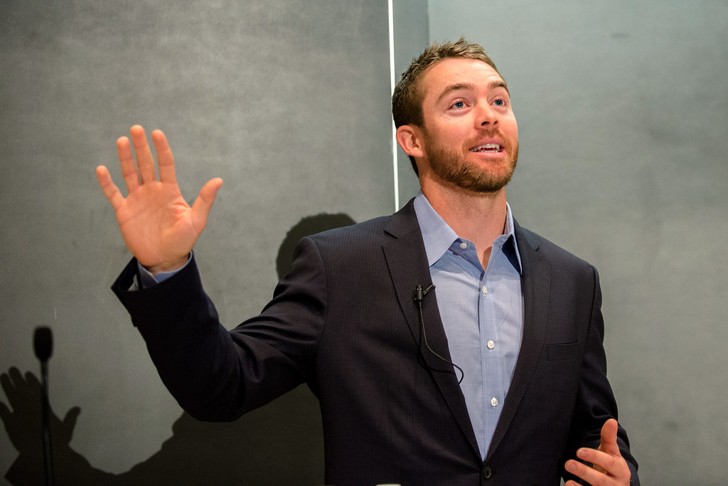 Students, faculty, and guests listen to NFL former Cleveland Browns and current Washington Redskins quarterback Colt McCoy speak on professionalism and leadership at the Air Force Academy's 23rd annual National Character and Leadership Symposium (NCLS) on