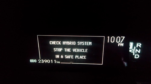 prius error message check hybrid system stop