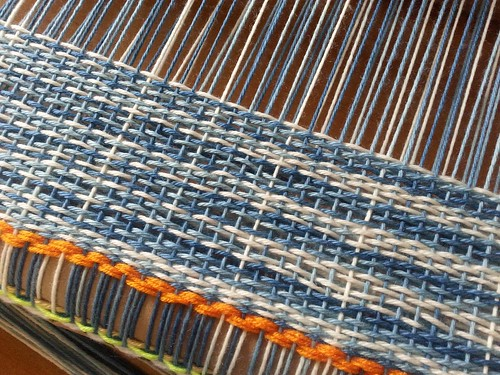 Weaving with the indigo dyed Andes superwash wool. This is doubleweave so it's twice as wide as the loom.