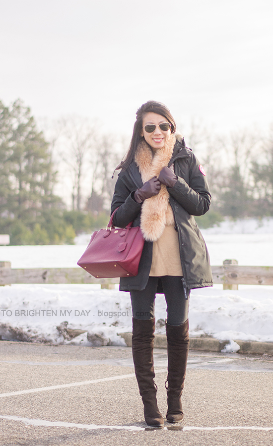 faux fur scarf, black parka, camel sweater tunic, purple red tote, plum gloves, brown suede over the knee boots