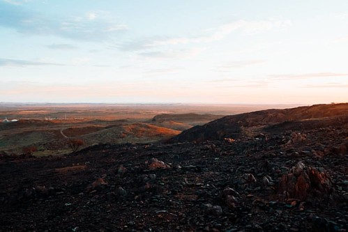 A fire has scorched part of the hills that border the town/city of Karratha. . We had a good walk up those hills last night for the sunset. When I say good, it was hard work, especially coming down the grade 4 trail an hour after the sun had disappeared.
