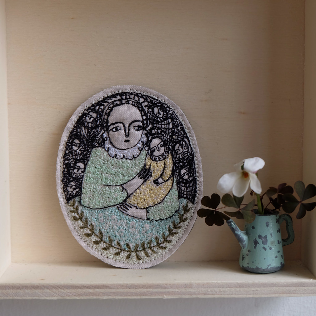 woman and child with leaf motif